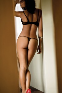 Black Bra and matching G-String with Red High Heels.