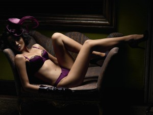 Purple Bra with black lace trim and matching Panties, Black Gloves and Purple Hat.