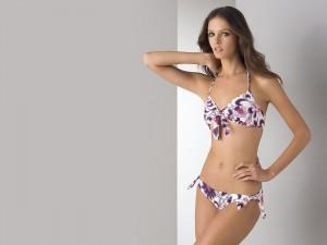 white purple and orange bikini swimware with bows