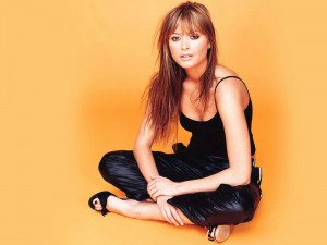 Holly Valance in a black camisol with black wet look track pants