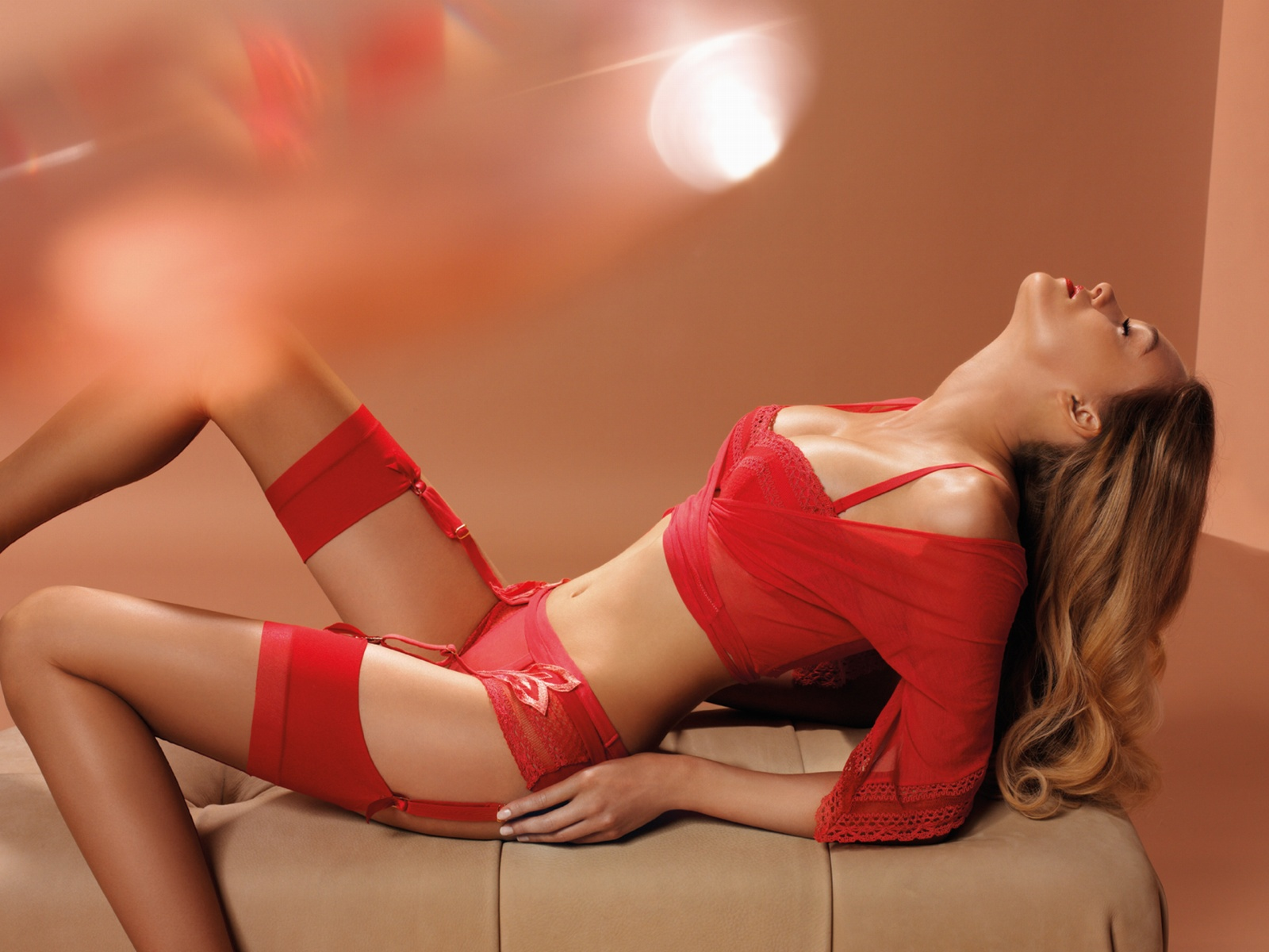 Red Bra With Red Camisol Knickerts And Suspenders And Red Stockings Smal Light Flower Motif