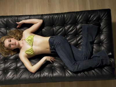 Yellow,satin bra topblue jeans black couch