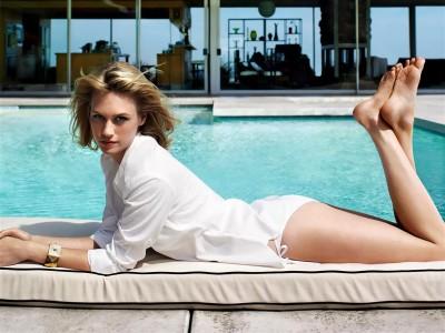 White,shirt gold bracelet white bikini bottom